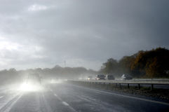 Hazardous driving in wet. Driving in hazardous wet conditions on a motorway Royalty Free Stock Image