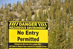 Hazardous Environment. Dangerous Hazardous Environment Signage on Mountain Ski Resort stock photography