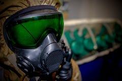 Hazardous environment gas mask with safety glass. Afraid apparatus army biohazard black breathe chemical concept danger defense destruction equipment face fear stock photography