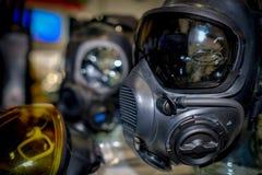 Hazardous environment gas mask with safety glass. Afraid apparatus army biohazard black breathe chemical concept danger defense destruction equipment face fear stock photos