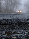 Hazardous foggy road Royalty Free Stock Image