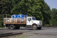 Hazardous Material. Truck transporting hazardous chemicals crossing a railroad track stock image