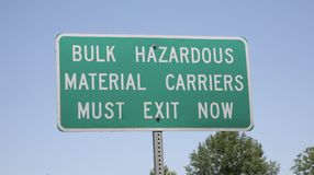 Hazardous Material Carriers. A highway sign alerts carriers of hazardous materials that they must exit the road or freeway at this point stock photo