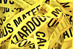 Hazardous Material Tape. Pile of yellow plastic tape marked Cautious Hazardous Material royalty free stock images