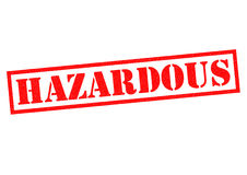 HAZARDOUS. Red Rubber Stamp over a white background Royalty Free Stock Photo