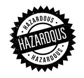 Hazardous rubber stamp. Grunge design with dust scratches. Effects can be easily removed for a clean, crisp look. Color is easily changed Royalty Free Stock Photo