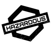 Hazardous rubber stamp. Grunge design with dust scratches. Effects can be easily removed for a clean, crisp look. Color is easily changed Stock Photos