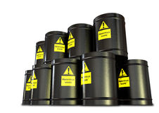 Hazardous Waste Barrel Stack. A stack of black metal barrels with yellow hazardous waste labels on each stock image