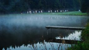 Haze above a pond in camp Royalty Free Stock Image