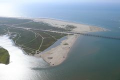 Aerial view of  the Texas Gulf Coast, Galveston Island, United States of America. Haze due to warm weather conditions. View of Bluewater Highway, San Luis Beach Stock Photos