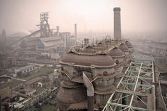Haze enveloped the steel plant Royalty Free Stock Image