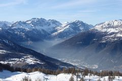 Haze in the mountain vale(horizontal). Haze in the mountain vale horizontal in Italy Stock Photo