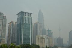 Haze over Kuala Lumpur, Malaysia. The haze is a fire-related large-scale air pollution problem that occurs regularly. The problem flares up every dry season, in Royalty Free Stock Photography