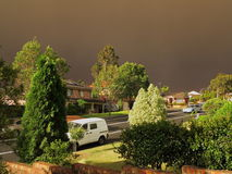 Dark haze over village by bushfires Stock Photography