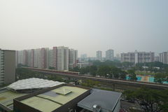 Haze pollution in Singapore. SINGAPORE - A prolonged spell of haze has affected Singapore this year, with forest fires in neighbouring Indonesia contributing to Stock Image