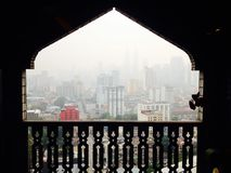Haze smog pollution over Kuala Lumpur through unique Mosque window Stock Photos