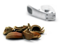 Hazel nut shells and cracker. On white background royalty free stock image