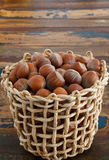 Hazel nuts in wicker busket on table Royalty Free Stock Images