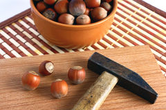 Hazelnut. Basket with hazelnuts and a hammer for splitting nuts Stock Photo