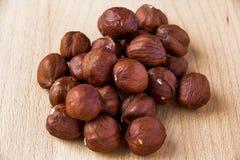 Hazelnut. A handful of hazelnut on wooden table Stock Images