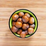 Hazelnut in bowl Royalty Free Stock Photos