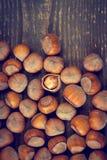 Hazelnut broken up on a wooden board Stock Image