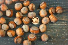 Hazelnut broken up on a wooden board Stock Photo