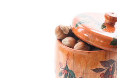 Hazelnut brown in wooden pot Royalty Free Stock Photo