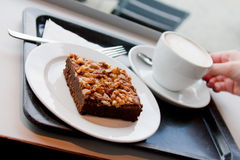 Hazelnut cake and coffee. Served in cafeteria Royalty Free Stock Images