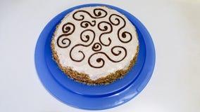 Hazelnut cake. Wonderful hazelnut cake on a blue tray Stock Image