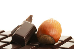 Hazelnut and chocolate on a chocolate bar Stock Photo