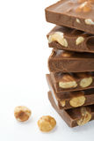Hazelnut chocolate on white Royalty Free Stock Photos