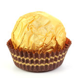 Hazelnut chocolate wrapped in golden foil Royalty Free Stock Photography