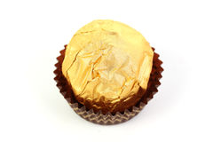 Hazelnut chocolate wrapped in golden foil Royalty Free Stock Photos