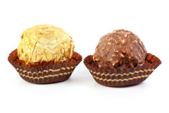 Hazelnut chocolate wrapped in golden foil Stock Images