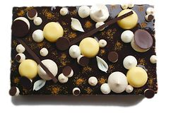 Hazelnut and citrus coffee sheet cake with orange mousse and dark chocolate mirror glaze royalty free stock photo
