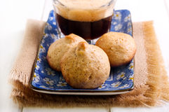 Hazelnut cookies. And glass of coffee on table royalty free stock photography