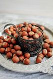 Hazelnut in a cup on a tray royalty free stock photography