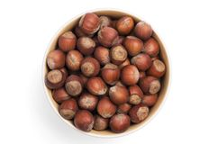 A cup full of hazelnuts royalty free stock photos