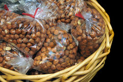 Hazelnut Filberts packaged inside of basket Stock Photos