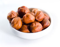 Hazelnut. Heap of unpeeled nuts  on white Royalty Free Stock Images