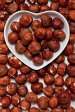 Hazelnut in heart shaped tray Royalty Free Stock Images