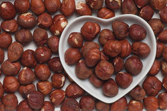 Hazelnut in heart shaped tray Stock Images