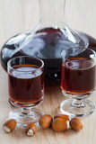 Hazelnut liqueur in a carafe Royalty Free Stock Photography