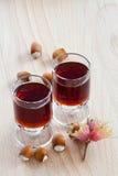Hazelnut liqueur and Hazelnuts Royalty Free Stock Images