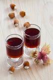 Hazelnut liqueur and Hazelnuts Stock Photos