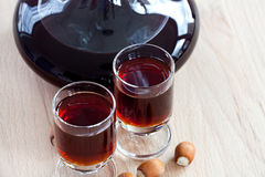 Hazelnut liqueur in two glasses with Hazelnuts Royalty Free Stock Images