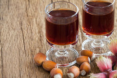 Hazelnut liqueur in two glasses and hazelnuts Stock Photography
