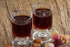 Hazelnut liqueur in two glasses and hazelnuts Royalty Free Stock Images