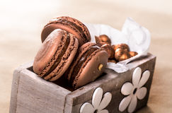 Hazelnut macarons in wooden box. Wrapped in paper Royalty Free Stock Photo